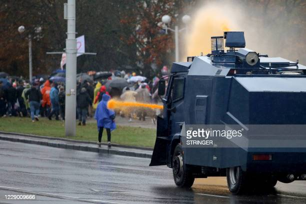 Graphic content / Police use a water cannon truck to disperse demonstrators during a rally to protest against the Belarus presidential election...