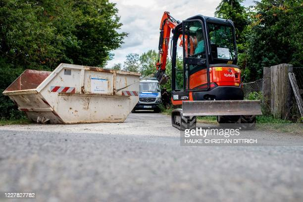 Graphic content / Police work during a search in a garden allotment in the northern German city of Hanover on July 29 in connection with the...