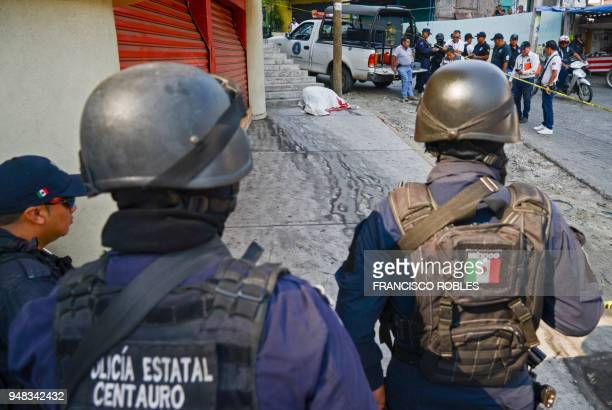 Graphic content / Policemen arrive at the crime scene where a young man was gunned down by armed men in the neighborhood of La Cima in the convulsive...