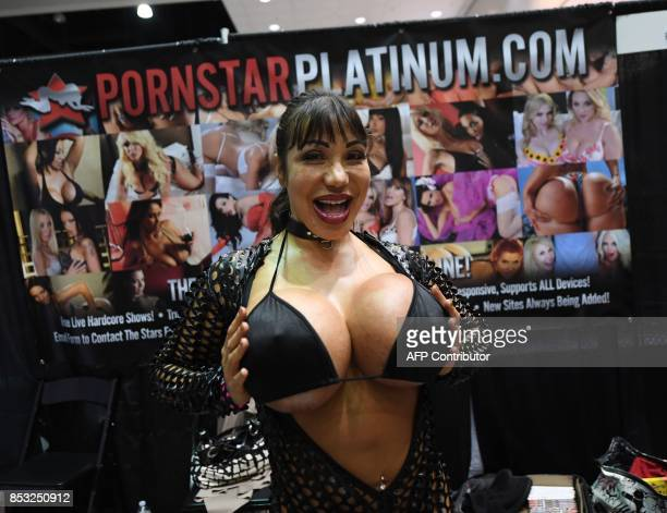 Graphic content / Porn star Ava Divine poses during the annual 'AdultCon' Adult Entertainment Convention in Los Angeles California on September 24...