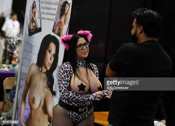 Graphic content / Porn star Sheridan Love greets a fan during the annual 'AdultCon' Adult Entertainment Convention in Los Angeles California on...