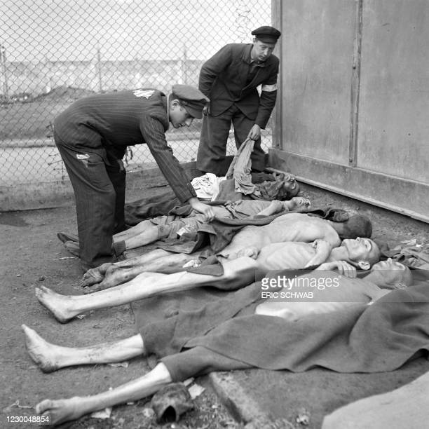 Graphic content / Prisoner's dead bodies are lying on the ground in Dachau concentration camp in late April or early May 1945, after the camp was...