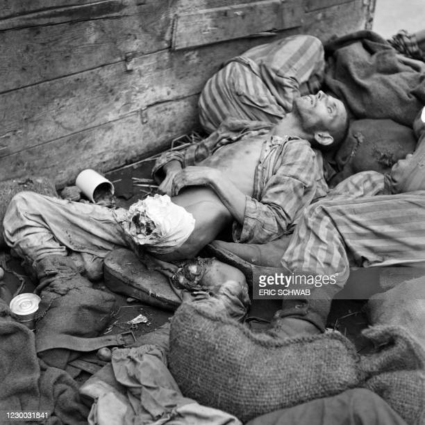 Graphic content / Prisoner's dead bodies are stacked in a train near Dachau concentration camp in late April or early May 1945, after the camp was...