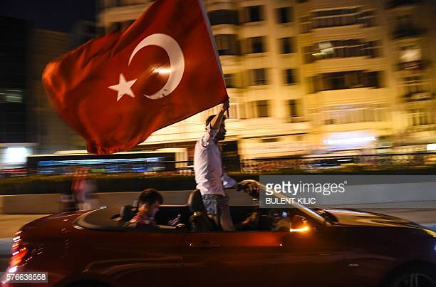 Graphic content / ProErdogan supporters gather at Taksim square in Istanbul to support the government on July 16 following a failed coup attempt...
