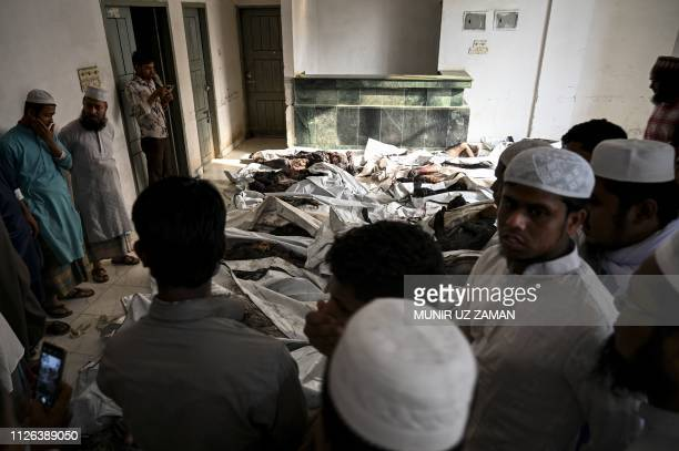 Graphic content / Relatives and onlookers gather at the morgue to identify bodies of residents who died during a fire in Bagladesh's capital Dhaka on...