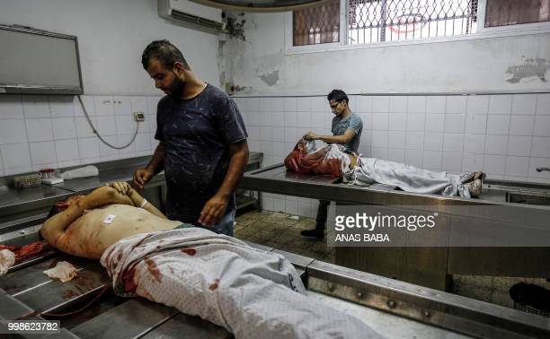 Graphic content / Relatives come to the morgue of alShifa hospital in Gaza City on July 14 2018 to identify the bodies of two Palestinian teenagers...