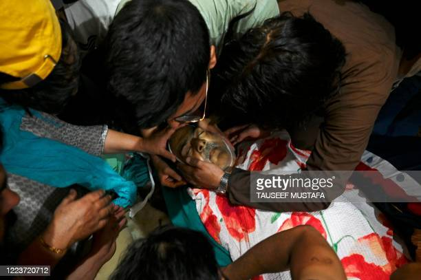 Graphic content / Relatives mourn over the body of Bashir Ahmed, a civilian who died during a gun-battle between government forces and suspected...