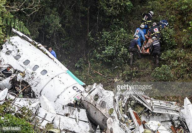Graphic content / Rescue and forensic teams recover the bodies of victims of the LAMIA airlines charter that crashed in the mountains of Cerro Gordo...
