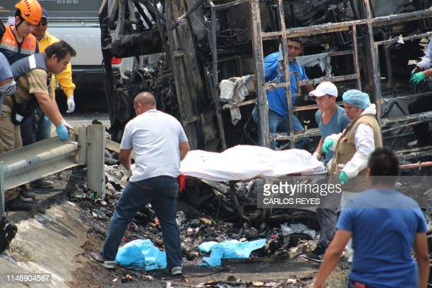 Graphic content / Rescue personal and forensic workers remove bodies at the site of a road accident in Coatzacoalcos state of Veracruz Mexico on May...
