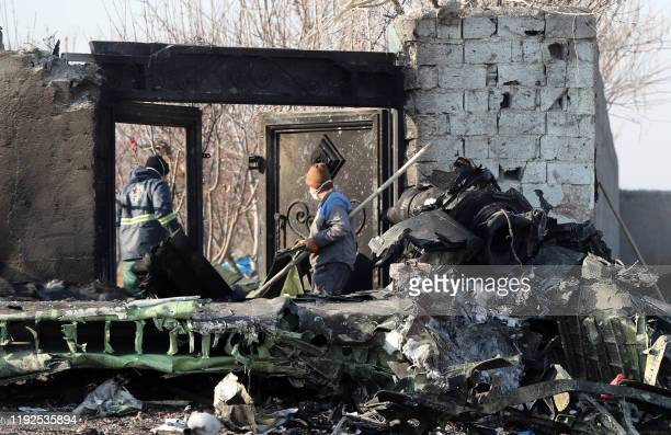 Graphic content / Rescue teams work amidst debris after a Ukrainian plane carrying 176 passengers crashed near Imam Khomeini airport in the Iranian...