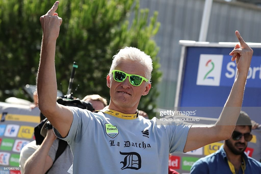 Graphic content / Russia's Tinkoff cycling team owner Oleg Tinkov reacts at the end of the 162,5 km eleventh stage of the 103rd edition of the Tour de France cycling race on July 13, 2016 between Carcassonne and Montpellier. / AFP / KENZO