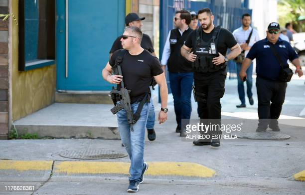 Graphic content / Sinaloa's state police officer walks at a cordoned-off area after heavily armed gunmen waged an all-out battle against Mexican...