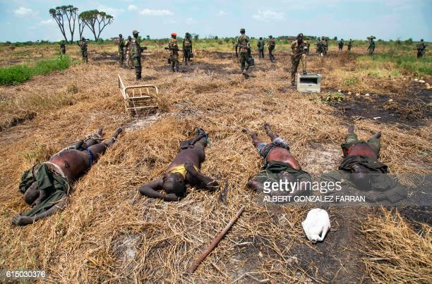 Graphic content / Soldiers of the Sudan People Liberation Army patrol near to dead bodies of rebel soldiers in Lelo, outside Malakal, northern South...