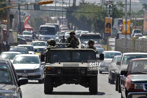 Graphic content / Soldiers patrol an avenue in Guadalajara, Jalisco State, Mexico, on November 22, 2019. - AFP has mobilized several of its...
