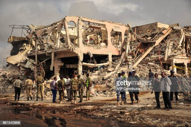 Graphic content / Somali security officers patrol on the scene of the explosion of a truck bomb in the centre of Mogadishu on October 15 2017 A truck...