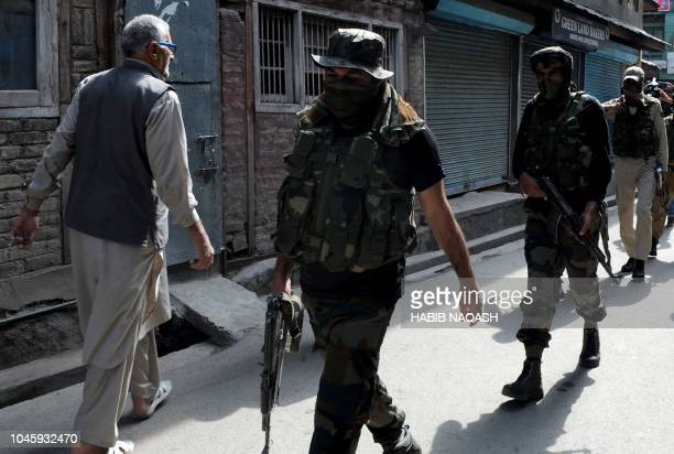 Graphic content / Special Operation Group of Jammu and Kashmir Police personnel searches for suspected militants who killed two National Conference...