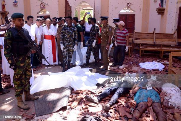 Graphic content / Sri Lanka soldiers and religious members of the parish look on inside the St Sebastian's Church at Katuwapitiya in Negombo on April...