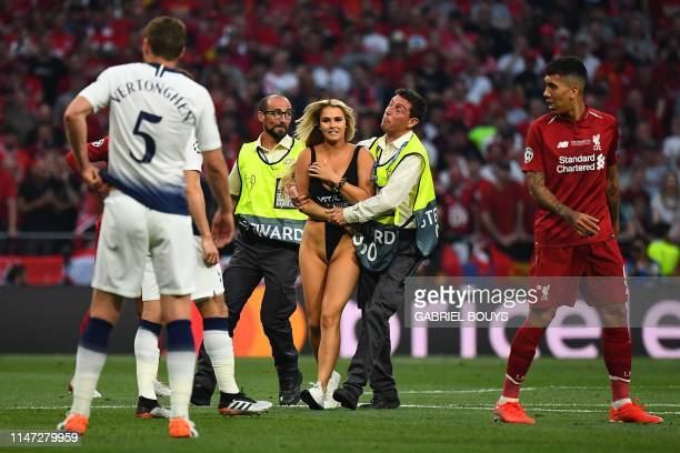 Graphic content / Stewards escort a pitch invader during the UEFA Champions League final football match between Liverpool and Tottenham Hotspur at...