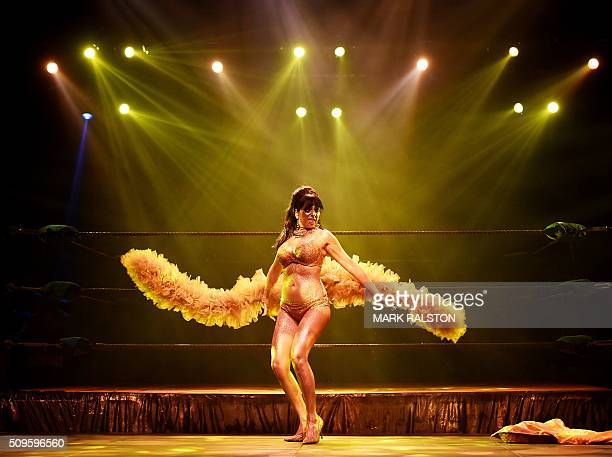 Graphic content / Striptease artist Moana Santana performs for the audience during the Lucha Va Voom's 'Crazy in Love' show at the Mayan Theatre in...