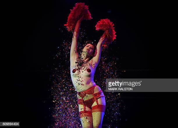 """Graphic content / Striptease artist Molly D'Armour performs for the audience during the Lucha Va Voom's """"Crazy in Love"""" show at the Mayan Theatre in..."""