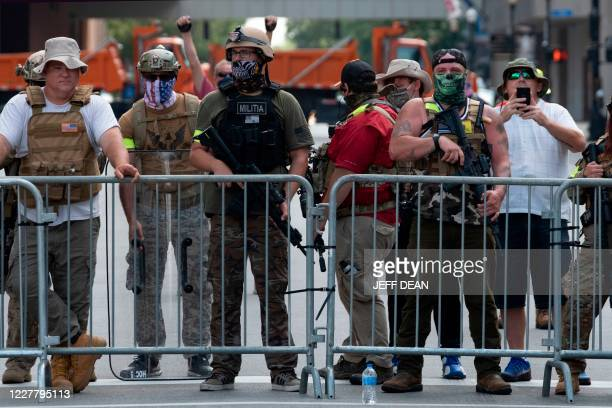 """Graphic content / Supporters of the Kentucky Three Percenters militia gather during a rally by """"Not Fucking Around Coalition"""" , an all black militia,..."""