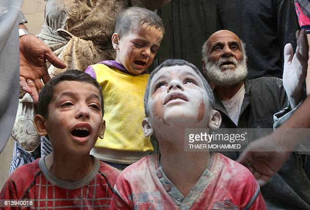 Graphic content / Syrian boys cry following Russian air strikes on the rebelheld Fardous neighbourhood of the northern embattled Syrian city of...