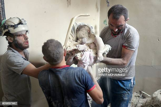 Graphic content / Syrian civil defence volunteers known as the White Helmets retrieve bodies from under the rubble of a building following a reported...