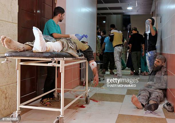 Graphic content / Syrians wait to receive treatment at a hospital following Russian air strikes on the rebelheld Fardous neighbourhood of the...