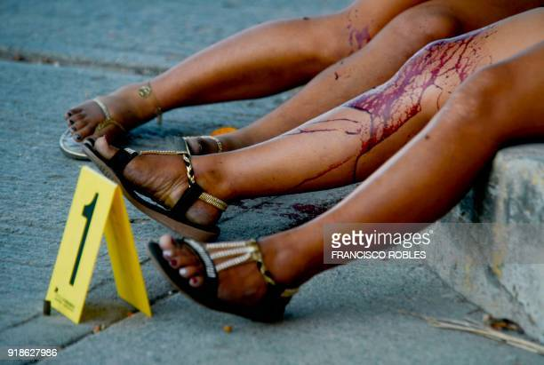 Graphic content / The bodies of a women lie on the sidewalk of a street killed on the Rufo Figueroa neighborhood of Acapulco city port Guerrero state...