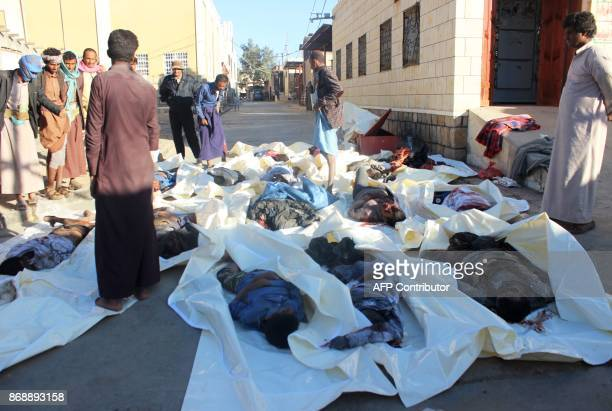 Graphic content / The bodies of men killed by an air strike on the Sahar district of the northern Yemeni governorate of Saada are seen at the yard of...