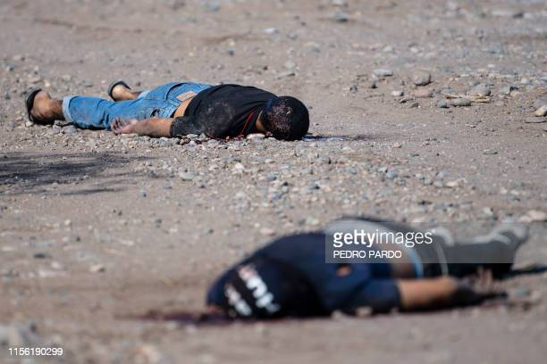 Graphic content / The bodies of two men killed during a shooting lay on the ground in Culiacan Sinaloa Mexico on July 17 2019 Residents of Culiacan...