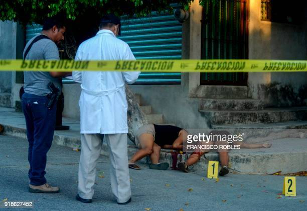 Graphic content / The bodies of two women lie on the sidewalk of a street killed on the Rufo Figueroa neighborhood of Acapulco city port Guerrero...