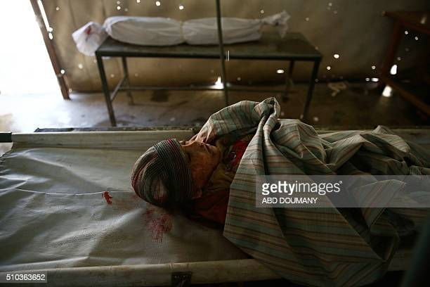 Graphic content / The body of a child is seen in a makeshift morgue after he was killed in an air strike on the besieged rebelcontrolled city of...