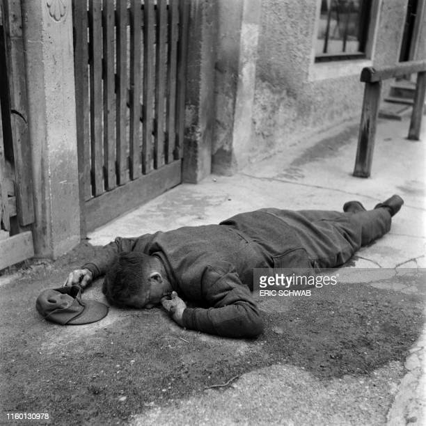 Graphic content / The body of a German soldier lies on the floor of the Dachau concentration camp after the US army liberated the camp 29 April 1945...