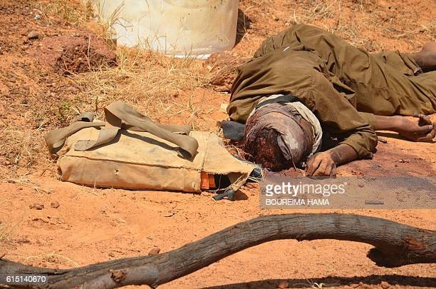 Graphic content / The body of a man laid next to a an explosive belt in front of the the prison of Koutoukale near Niamey following an attack on...