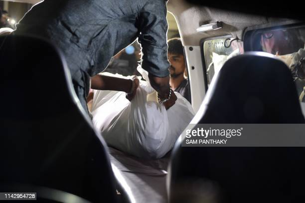 Graphic content / The body of a Muslim woman Nasrin Banu Shaikh is being kept inside an ambulance by her family members from the postmortem room of...
