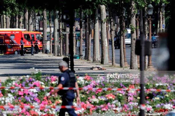 Graphic content / The body of a suspect lying in a sealed off area of the ChampsElysees avenue in Paris on June 19 after a car crashed into a police...