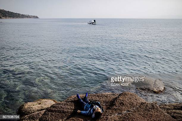 Graphic content / The body of migrant child is washed ashore on the beach in Canakkale's Bademli district on January 30 2016 after at least 33...