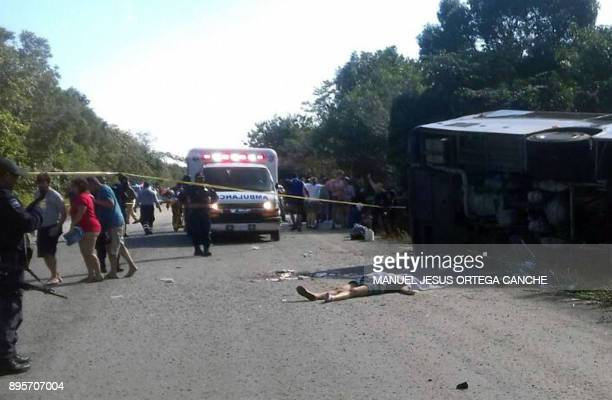 Graphic content / The body of one of the victims of a road accident lays on the floor where a bus driving tourists to Chacchoben archaeological zone...