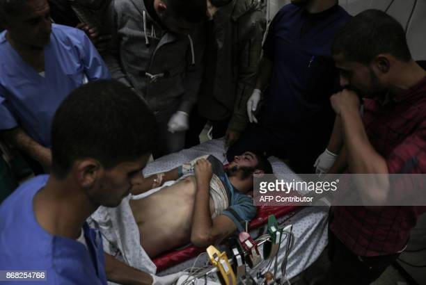 Graphic content / The body of Palestinian Marwan Alagha lies at Naser hospital in Khan Yunis after he was killed when Israel blew up what it said was...
