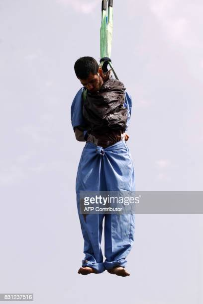 Graphic content / The body of Yemeni Hussein alSaket is seen hanging after being executed by security forces for raping and murdering a fouryearold...