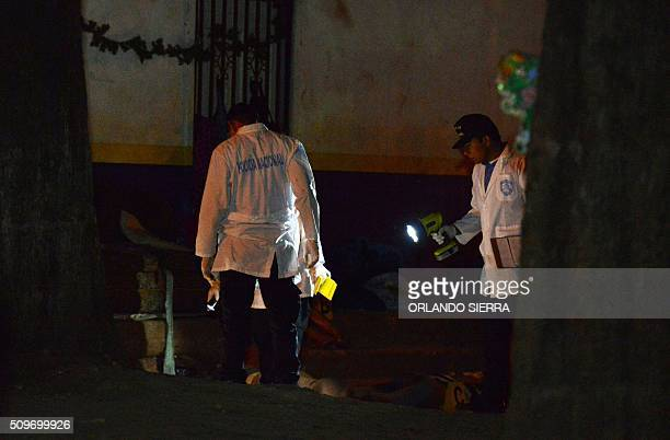 Graphic content / The corps of five young people murdered by gangs stay in the street in the popular neighbourhood Hato de Enmedio, in Tegucigalpa on...