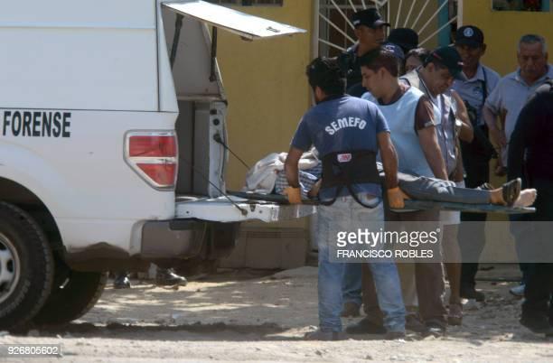 Graphic content / The corpse of the coordinator of Guerrero state Judicial Investigative Police Hector de la Rosa Moreno is loaded in a van by...