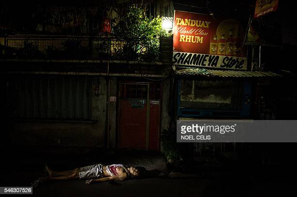 Graphic content / The dead body of an alleged drug dealer lies on the ground on a street in Manila on July 12 2016 The Philippine government's top...