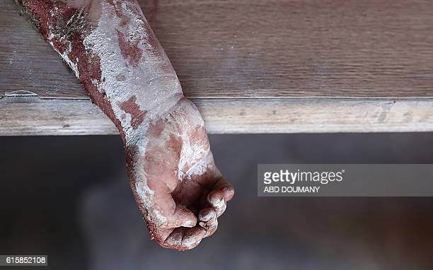 Graphic content / The hand of a dead Syrian girl is seen at a make-shift hospital in the rebel-held town of Douma, east of the Syrian capital...