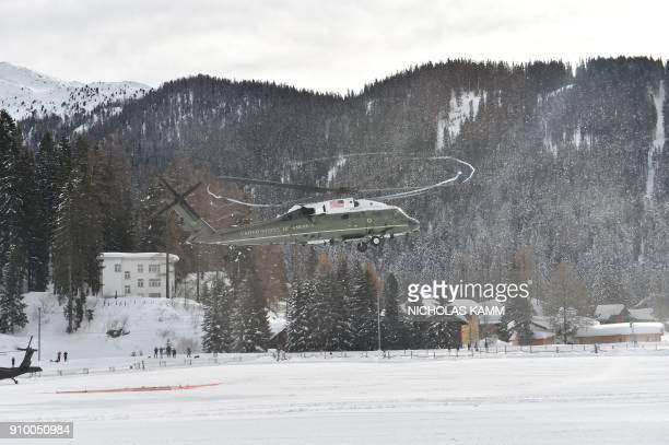 The 'Marine One' helicopter carrying US President Donald Trump comes in to land in Davos on January 25 2018 Trump arrived in the Alpine village where...