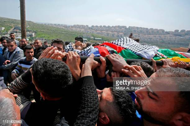 Graphic content / The mother of 26yearold Palestinian Ahmed Manasara kisses her son's body during his funeral in the village of Wadi Fukin west of...