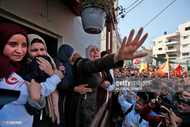 Graphic content / The mother of 26yearold Palestinian Ahmed Manasara bids farewell to her son's body during his funeral in the village of Wadi Fukin...