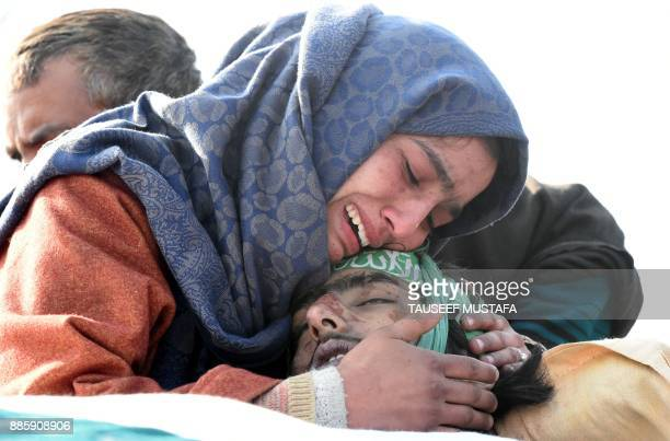 Graphic content / The sister of Indian Kashmiri militant Yawar Bashir cries over his body during a funeral procession at Hablish village of south...