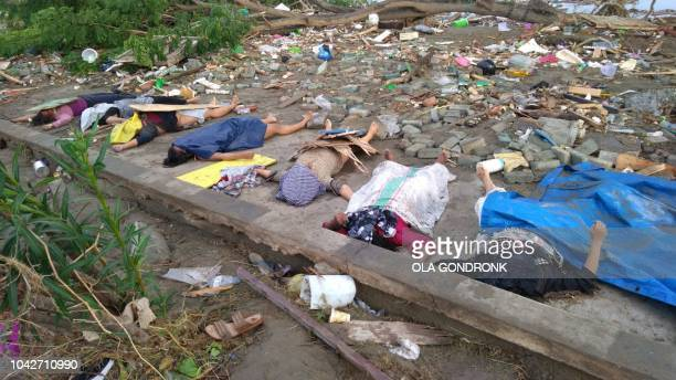 Graphic content / This photo shows bodies of victims of the earthquake and tsunami in Palu on Sulawesi island on September 29 2018 Rescuers scrambled...